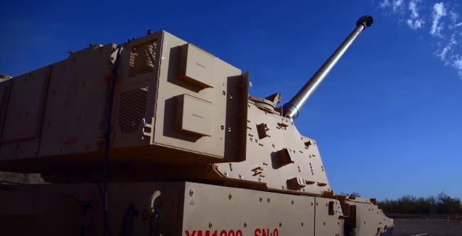 美国新型火炮发射制导炮弹命中65公里外汽车