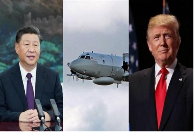 给习难堪?不甩十一国庆 美国5架军机飞越南海