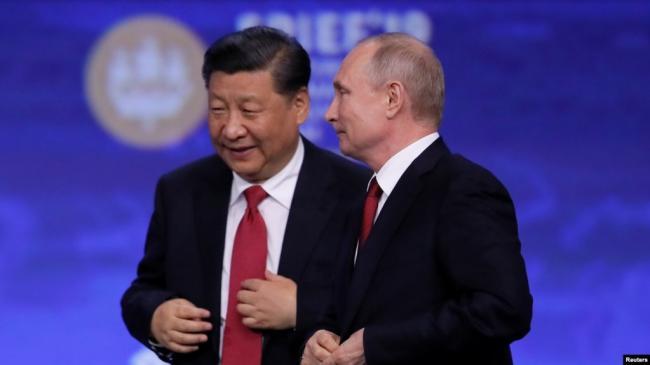 资料照片:中国国家主席习近平和俄罗斯总统普京在圣彼得堡出席国际经济论坛会议期间。(2019年6月7日)