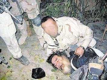 萨达姆被生擒时为什么不反抗?
